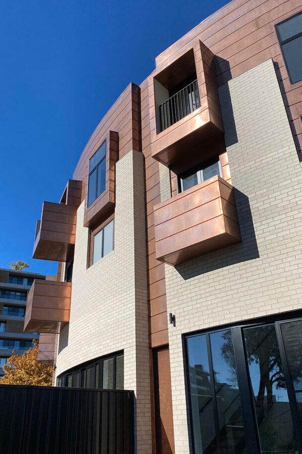 Exterior photo of Tempus building featuring copper detailing